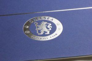 Silver foil emblem detail