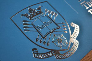 Silver foil on university coat of arms